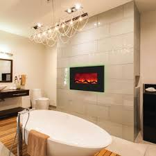 beautiful pendant lamp above white stand alone bathtub on modern bathroom with wall fireplace design