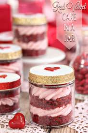 red velvet cake in a jar layers of red velvet cake and strawberry rose cream