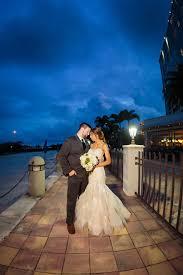 nighttime florida outdoor bride and groom wedding portrait on boardwalk ta bay wedding venue the westin ta bay destiny light hair and makeup