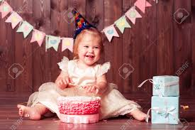 Laughing Baby Girl 1 Year Old Eating Birthday Cake In Room Wearing