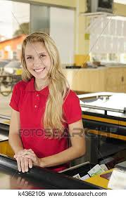 Woman Working As A Cashier At The Supermarket Stock