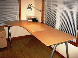corner ikea galant desk in brown with white windows blind also laminate wood floor for home