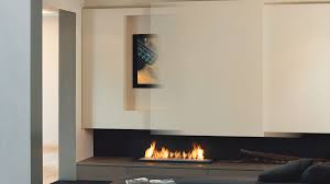 suspended fireplace with tv and sliding front