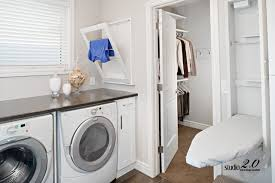 View in gallery Sleek white laundry room design ...