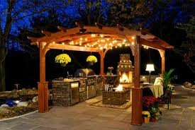 pergola lighting ideas. decorative outdoor string lighting for cool pergola design with fireplace and small kitchen ideas