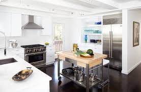 view in gallery midcentury kitchen with a cool kitchen island on wheels