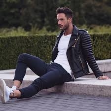 men s black quilted leather biker jacket white crew neck t shirt navy chinos white low top sneakers men s fashion lookastic com