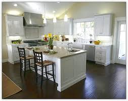 white kitchen cabinets with dark floors cream