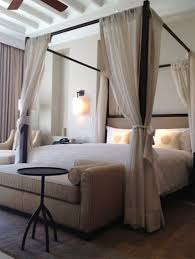 The modern edge of everything calms down the frilliness of the canopy. Kind  of cool. Canopied bed -- I always wanted a canopy bed, so sensual