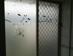 glass sliding door with decorative frosted window applied