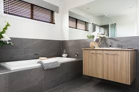 modern bathroom backsplash. Modern Bathroom Vanities Near Bathtub With Grey Granite Backsplash Tiles And Small Windows Wooden Blind Plus Towel On Decorated Flower O