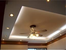 cove lighting with recessed lighting setup and classy ceiling fan with lamp for modern