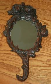 hand holding antique mirror. Antique Hand Carved Floral Black Forest Held Mirror 18\ Holding U
