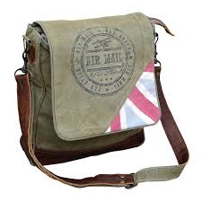 canvas and leather messenger bag by clea ray tap to expand