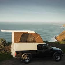 Streamlined pickup camper features lightweight composite design