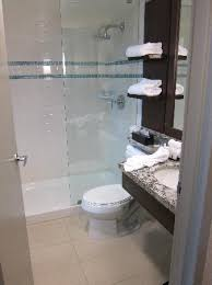 aava whistler hotel shower with half glass wall rain head water goes onto