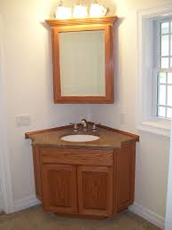 corner wooden vanity furniture with two panel doors complete with the drawer and undermount round sink that have brown granite countertop also amazing
