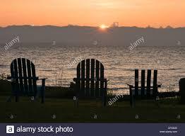 adirondack chairs on beach sunset. Wonderful Beach Adirondack Chairs Lined Up On The Beach At Sunrise Merville British  Columbia Canada Inside Chairs On Beach Sunset H