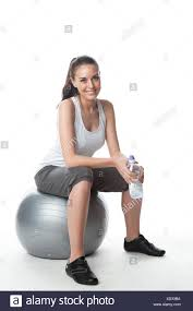 young woman sitting on gym ball