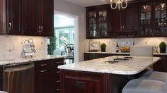 Kitchen dark cabinets light granite white trim Ideas for new