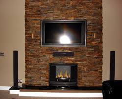 contemporary stacked stone wood burning firplace with dark gloss ceramic hearth under wall mount led tv elegant bathroom fireplace