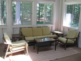 contemporary sunroom furniture. Contemporary Sunroom Furniture Design Displaying Dark Finish Solid Wood Plose Sofa With Green Padded Seat Cushion