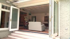 Image Sliding Patio Professional Builder Folding Patio Doors Bring The Outdoors In Todays Homeowner