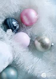 how to make glitter painted glass ornaments easy diy craft follow this tutorial