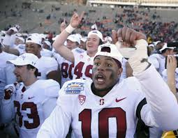 stanford players including outside linebacker jordan fox 10 celebrate their win over