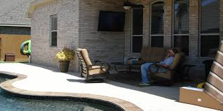 outdoor tv install on brick wall near swimming pool