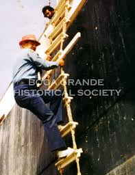 Captain Carey Johnson, boarding ship - Boca Grande Historical Society
