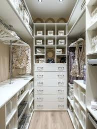 walk in closet remodel inspiration for a small contemporary light wood floor and beige floor walk walk in closet