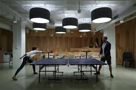 Office design companies office Workplace Arity Employees Playing Table Tennis At The Companys Office Inside The Merchandise Mart In Chicago Doxenandhue Suburban Companies Battle Tech Giants For Talent Downtown Office