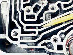 techtips gm th400 transbrake installation a 1 8 inch round file open up the partition in the picture do not scratch or nick the bore where the brake valve is located