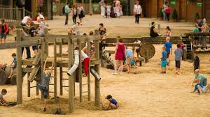york maze. families playing in the sand and water play area at york maze