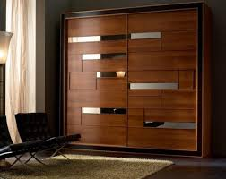... Mirrored surfaces and wood texture for closet door decoration