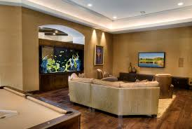 tank furniture. Charming Fish Tank Room Divider With Recessed Lighting And Dark Wooden Flooring For Modern Home Furniture