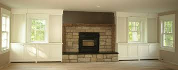 built in bookshelves fireplace windows powder room gym cabinets around window cool tv next to with home design the most amazing along custom ins bookcases