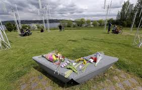 flowers sit on a bench at the sound garden sculpture for which the band soundgarden was named in seattle s magnuson park in tribute to chris cornell