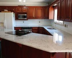 light color granite countertops kitchen countertop with sink cutout and cooktop cutout with dark