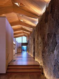 wood ceiling lighting. Faceted Wood Ceiling In Hallway With Natural Stone Wall Including Cove Lighting And Clerestory Window That C