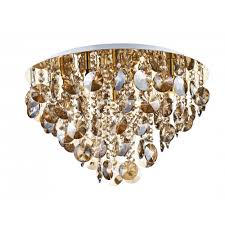 jester flush fitting gold ceiling light with amber droplets