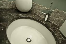 28ff9d9462792397ea957875c82ac095 Backsplashcontractor-river-rock-tile-natural-tile-renovations-metric-  ...