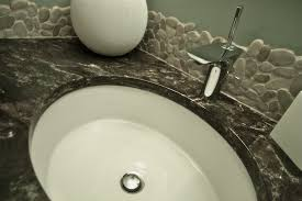 28ff9d9462792397ea957875c82ac095 backsplashcontractor river rock tile natural tile renovations metric
