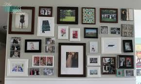 and finally i filled the empty picture frames with some of my favorite pics i used a new geometric fabric i found to fill one of my 8 10 frames up