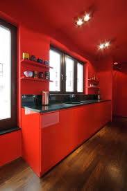 Chic Red Kitchen Cabinets Added Black Tiled Countertops As Well As Cool  Ceiling Lighting And Dark Wooden Floors Ideas