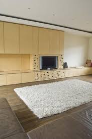 how to anchor area rugs to the floor