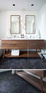 black and white diamond tile floor. 8 Examples Of Tile Flooring With Geometric Patterns // Dark Textured Diamond Tiles Make Up Black And White Floor E