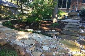 flagstone patio with grass. Landscape Flagstone Paths With Boulders And River Rock Patio Designs Grass