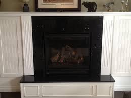 timeless granite surround fireplace